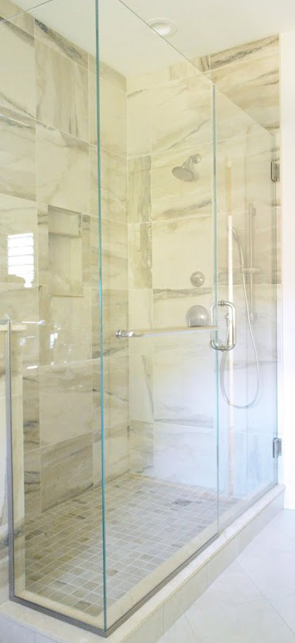 Custom glass enclosure showcases the custom tile work.jpg