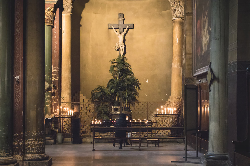 A quiet moment in one of the many shrines and chapels around the perimeter of St. Germain des Prés