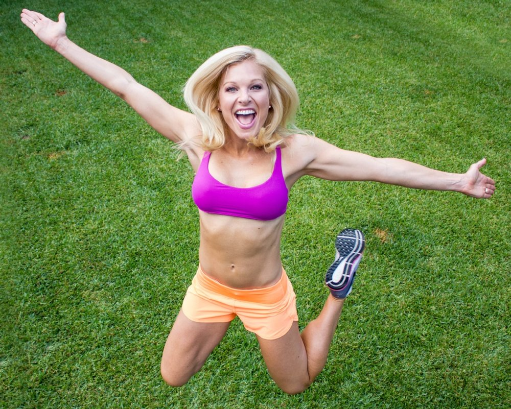 ACTION ANNA fucshia sports bra, orange shorts, green grass.jpg