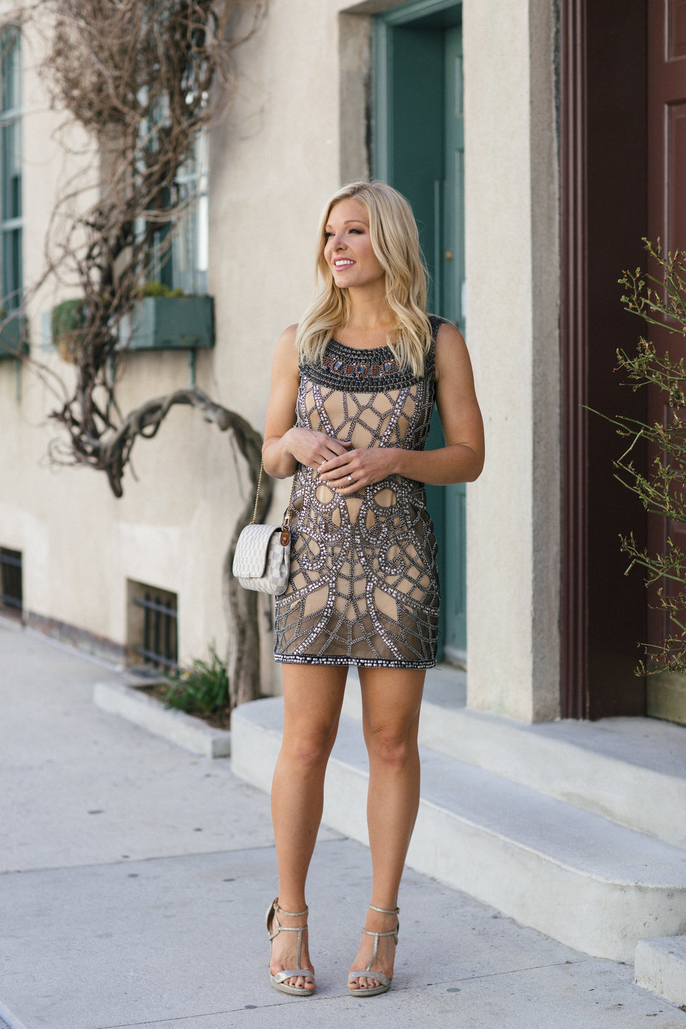 Anna Kooiman NYC West Village sequins neutral tones dress Louis Vuitton Dress Gold Michael Kors scrappy sandals looking out New York City Lydia Hudgens