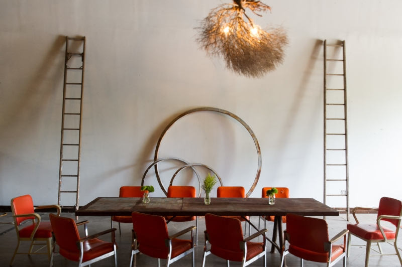 VukaInteriors-1123 orange chairs table greenery hoops 002.jpg