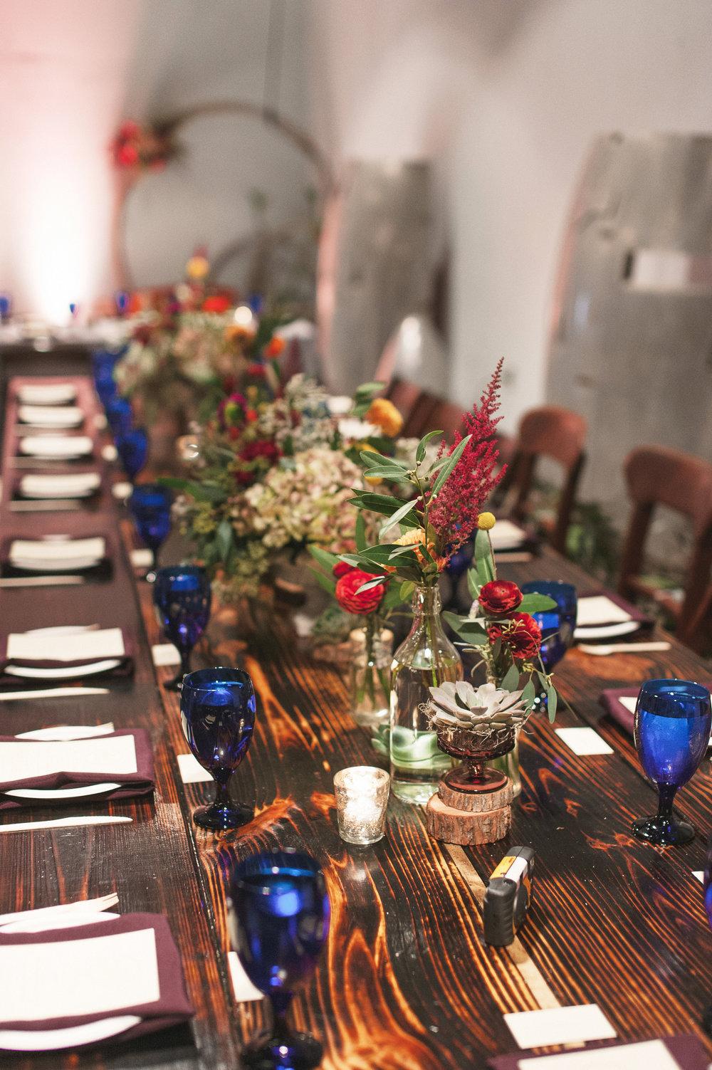 vuka wedding table setting closeup blue glasses.jpg