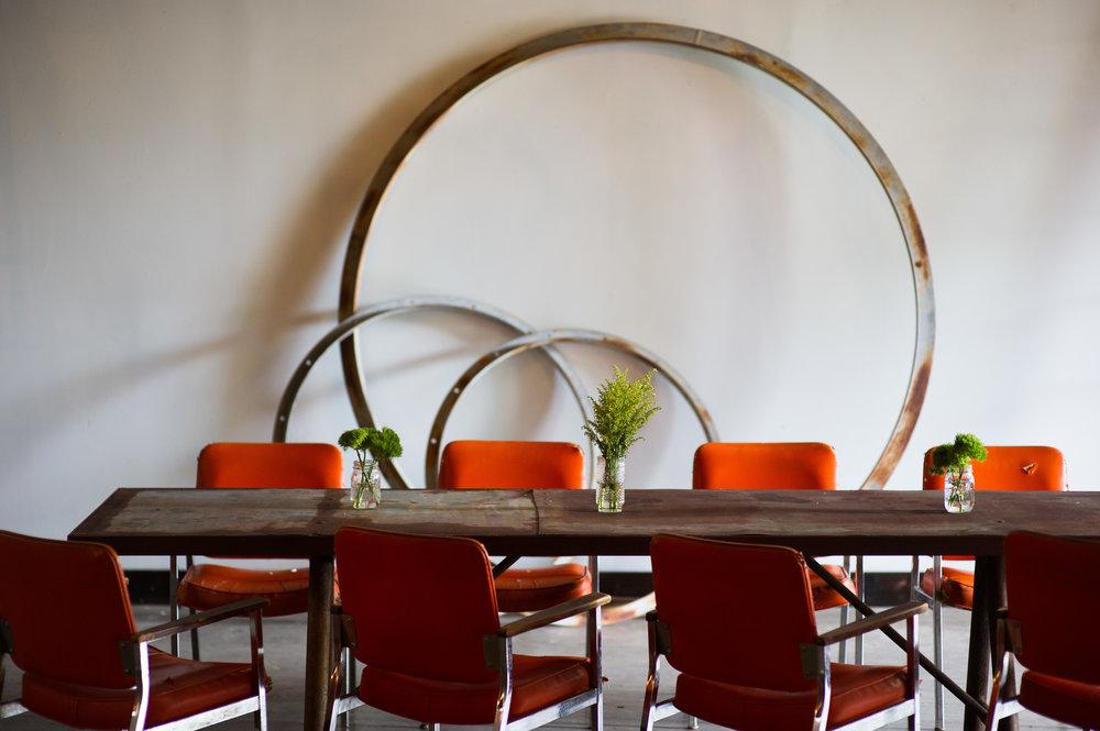 VukaInteriors-1130  orange chairs table greenery hoops 005.jpg