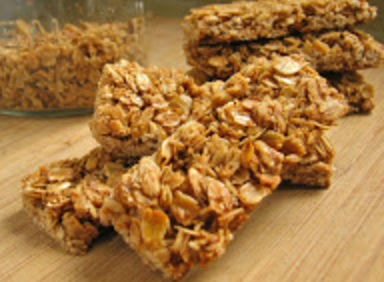 Granola Bars - Homemade granola bars are super easy to make and you'll know exactly what's in them. My kiddos love having these for a snack or breakfast!Ingredients:7 cups old-fashioned rolled oats1/2 cup vegetable oil1 teaspoon salt1 1/2 cups whole almonds, pecans, walnuts or peanuts 3/4 cup honey3/4 cup packed brown sugar1 Tablespoon vanilla extract2 teaspoons ground cinnamon (optional)Directions: Bake at 375 degrees. Line an 18 x 13 inch rimmed baking pan with aluminum foil. Combine the oats, oil and salt in a large bowl and mix until the oats are evenly coated. Transfer the mixture to the baking sheet and spread into an even layer. Bake, stirring every 10 minutes, until pale gold, 20-25 minutes. Remove the oats and lower the oven temp to 300 degrees. Place the nuts in a food processor and process until coarsely chopped. Or just chop coarsely with a big sharp knife. Combine the honey and brown sugar in a saucepan and cook over medium heat for about 5 minutes, stirring constantly, to dissolve the sugar. Remove from heat and stir in the vanilla and cinnamon (if using).Combine the oats, nuts, and honey mixture in a large bowl and stir with a large rubber spatula until the oats are thoroughly coated with the honey mixture. Spray the baking sheet (still with foil sling) with non-stick spray then transfer the granola mixture to the prepared baking sheet and spread in an even layer. Spray a large metal spatula or a square dish with non-stick spray and firmly press the mixture into the pan. Make a flat, tight, and even layer. Bake until golden, about 35-40 minutes. Cool in the baking sheet, on a wire rack, for 10-15 minutes before cutting into bars, I used a pastry scraper to cut.  Cut the bars all the way through and then allow the granola bars to completely cool. Do not wait longer than 15 minutes before cutting the bars. They harden up significantly as they cool. Any longer and you'll have a very hard time cutting thru them.Enjoy!!