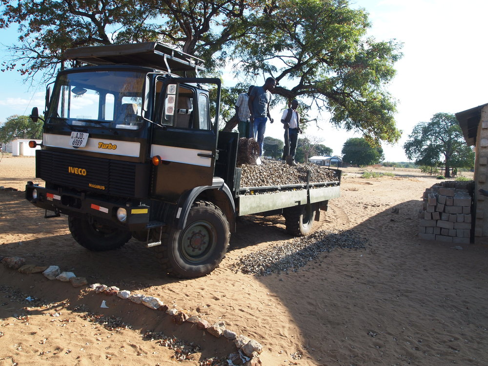 Delivering stones for a building foundation