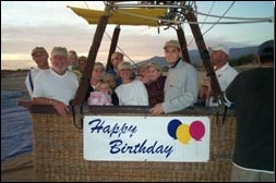 Celebrate a birthday, anniversary, graduation or promotion in one of our hot air balloons! Let that special person know how much you care. Tell us about the birthday when you book your flight and we will hang our Happy Birthday banner on the basket for you. Celebrate your special day while floating over the breathtaking desert scenery! Let us know about your anniversary and fly with a Happy Anniversary basket banner attached! Celebrate those special occasions such as graduations and promotions with a spectacular view of the desert landscape! Mention your special occasion when you book your balloon ride and we will provide a basket banner saying CONGRATULATIONS. A customized banner is an additional $100. Please let us know in advance, so we have time to create it.