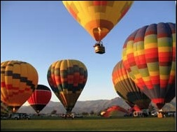 CORPORATE EVENTS: What a great way to cement business relationships and utilize unique team building skills! Book your group on an exciting balloon adventure! LARGE GROUPS: We have provided balloon rides for groups of up to 100 people. The number of balloons used will depend on the number of passengers booked to fly. Prices vary and need to be quoted on a case by case basis. PleaseContact Usfor more information. We have fun events, such as everyone in the balloon drops a bag towards an X on the ground. The passenger who gets the closest receives a discount on their flight. Please see our Balloon Adventuresfor details about these special flights. TETHERED BALLOON RIDES: Perfect for large outdoor events, tethered rides allow everyone a chance to ride in a hot air balloon without leaving the party!Contact Usnow to talk about your options.