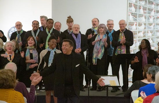 The Mill City Singers performed in their signature hand painted scarves.  Photo by Ric Rosow