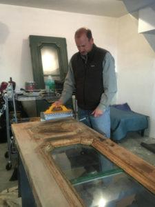 Peter Cooke refinishing Pickering House doors