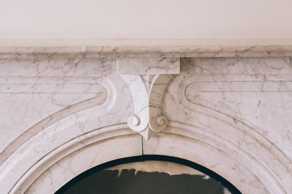 Close up of marble fireplace in Gathering Room