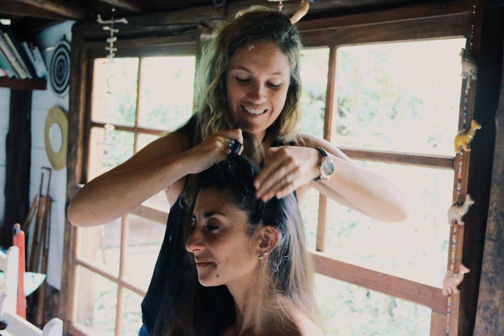 Giving Maia a braid.