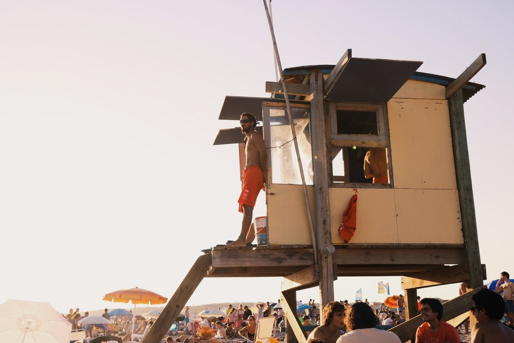 Lifeguards watching over the crowded beach.