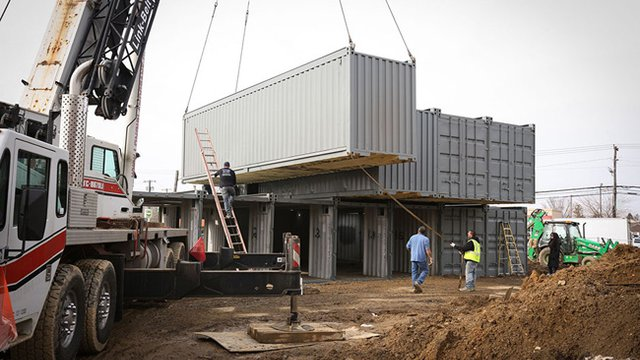 Storage containers will be used to construct the retail store. Photo courtesy of SG Blocks