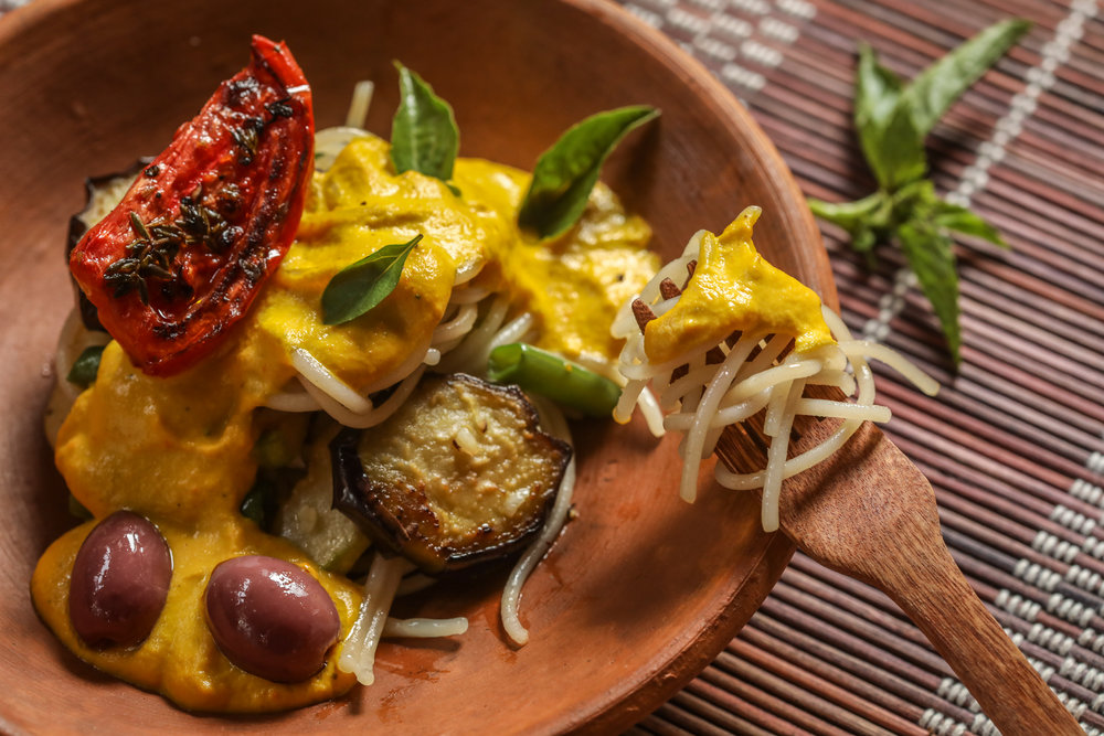 This photo is of vegan, gluten-free Huancaina pasta.