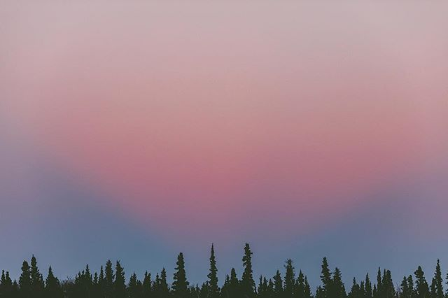 """While I was in the Yukon, the sky lit up with vibrant pinks and purples. This interesting """"V"""" shaped pink section had me stumped. The sun had been set for a little while, so I'm not sure what made this happen! Any ideas? PS: Print shop sale is happening right now! Use the code """"FEELTHELOVE"""" for 20% off your entire order this week (link to the print shop is in my profile!). I'm also throwing in a surprise free print with every order. This image and others have been added :) Enjoy!"""