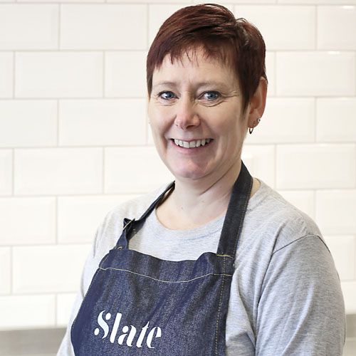 Julie Barnes - Julie works behind-the-scenes at Slate, looking after our online orders and other important things/admin to keep us all on track.Before joining us in May 2017, Julie ran her own face painting business for 14 years, but has now hung up her brushes which gives her time to enjoy weekends caravanning with her family. Julie is a big fan of Kim's fresh salads especially the beetroot salad and her favourite cheese is feta.