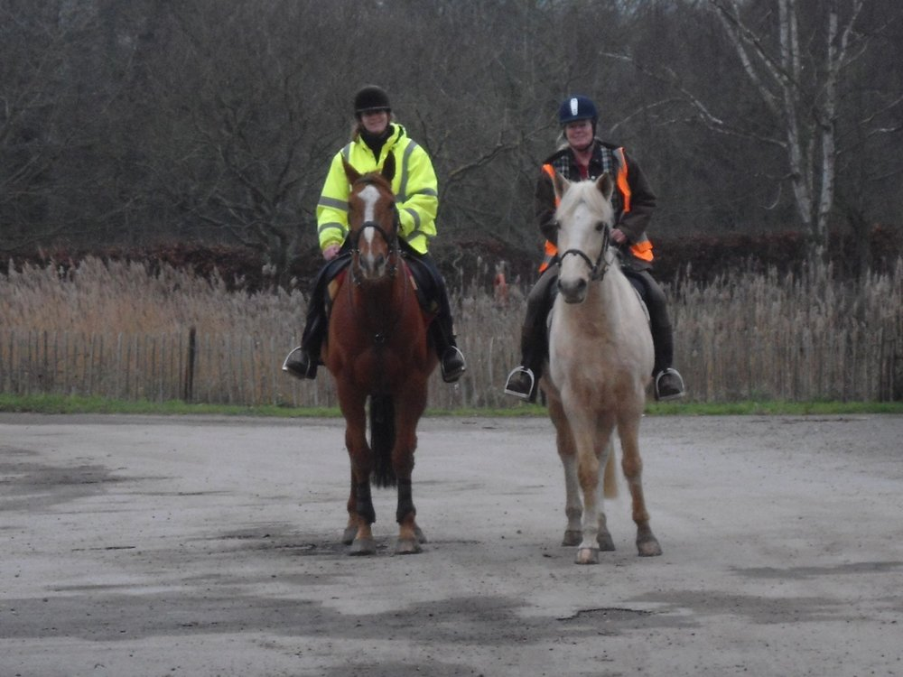 Sam (right) riding her horse