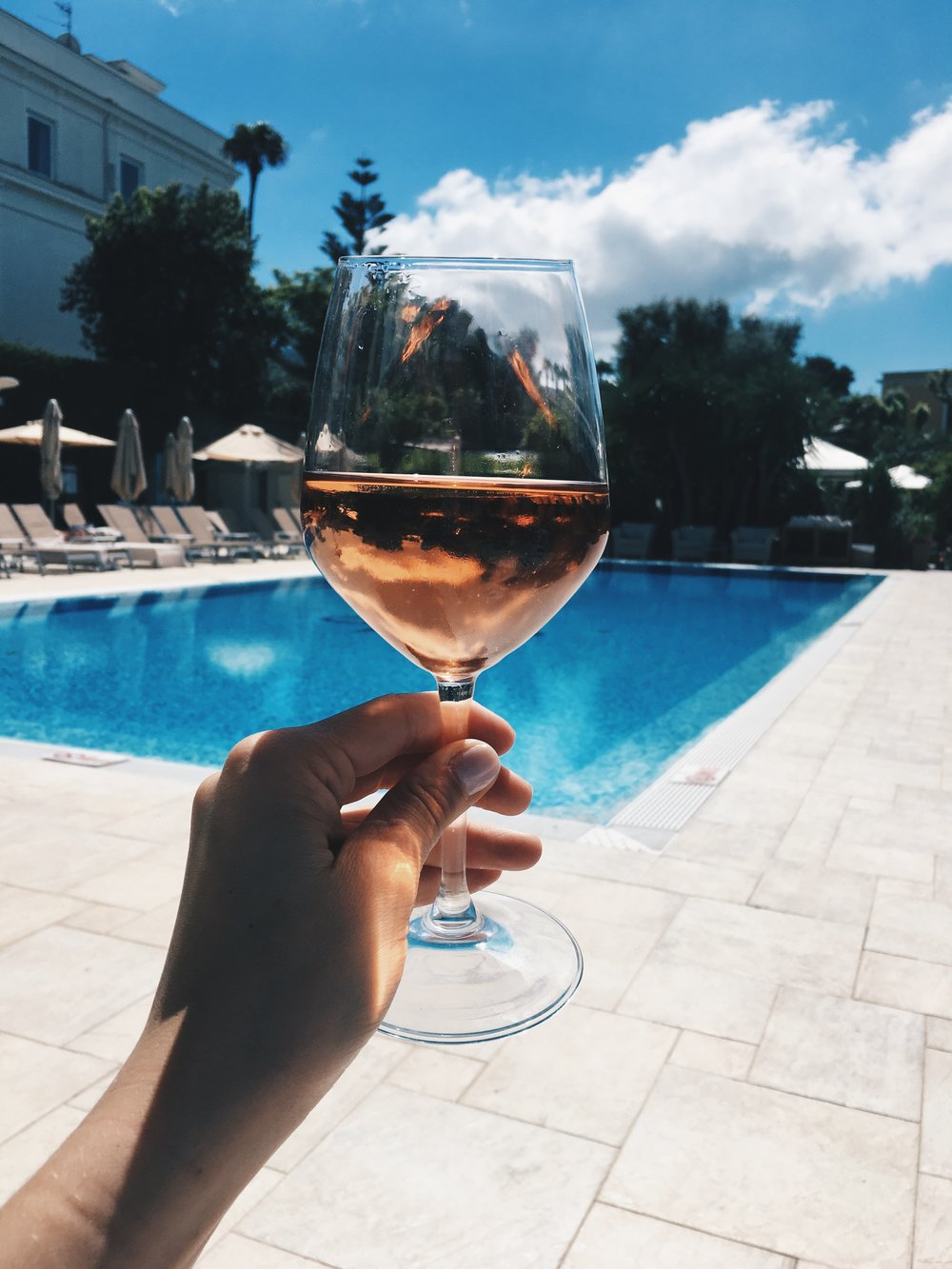 A glass of Rose by the pool.