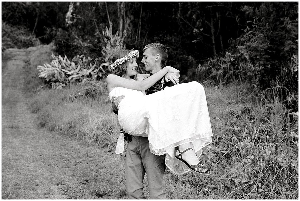 Maui groom carrying bride
