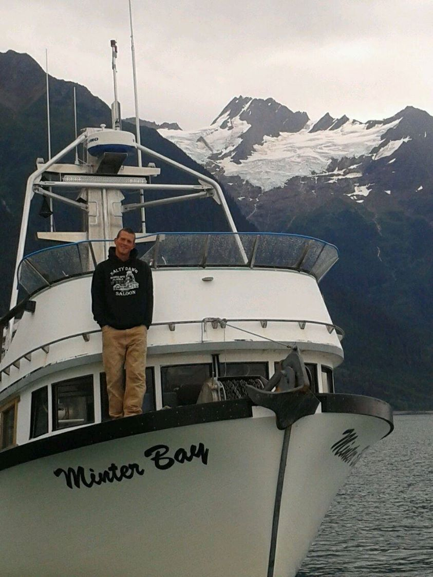 Zack aboard the Minter Bay in 2014, east of Eldred Rock.