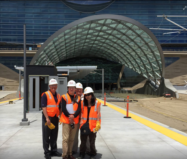 Cho with engineers at the Denver International Airport rail station