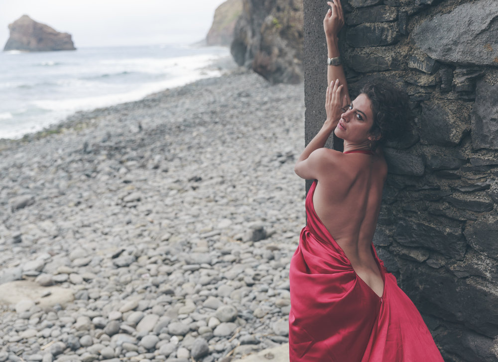 Woman who lives at the end of time and at the edge of the world... Somewhere between seven oceans of the universe she dances barefoot on bones and souls...   Location - Madeira Island, Portugal