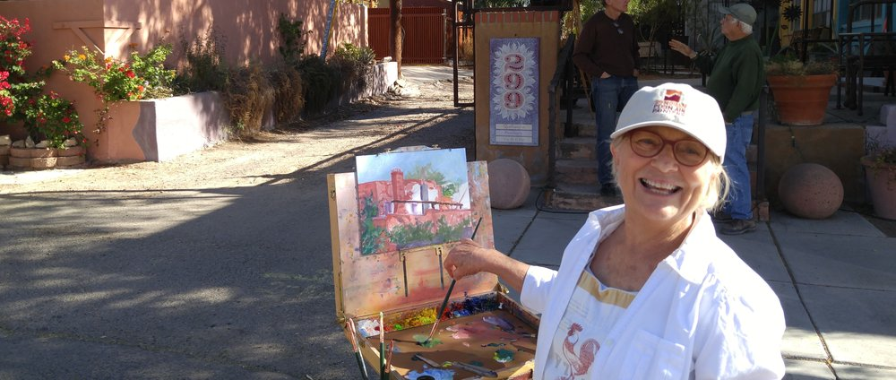 JOYCE NELSON PAINTING WITH THE BARRIO GANG (MEMBERS WHO LOVE TO PAINT OLD BUILDINGS IN TUCSON)
