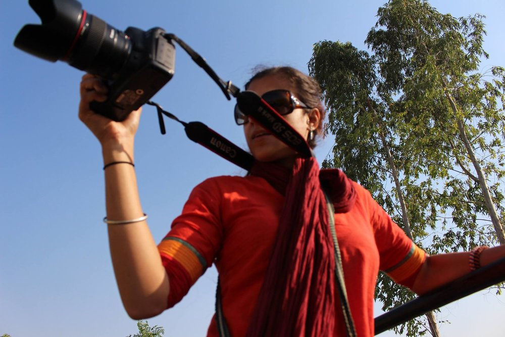 Rehmat filming from the jeep
