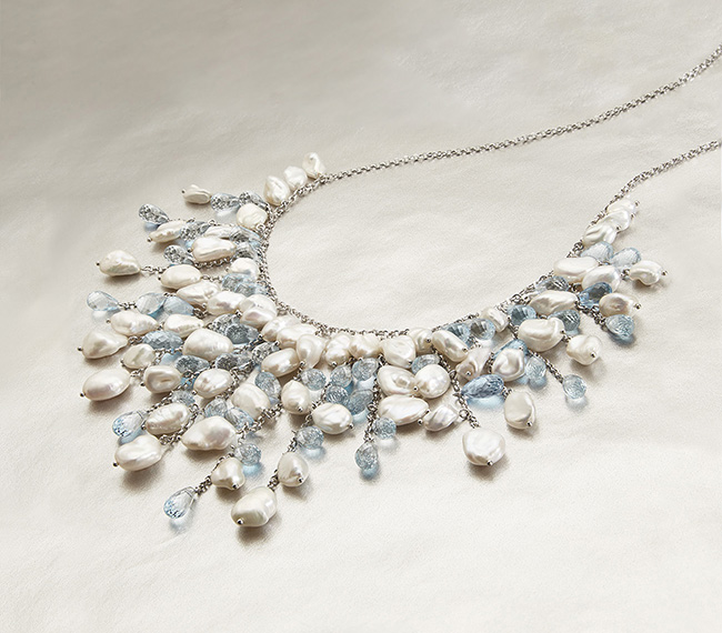SKYLINE Get drawn in by the silhouettes and color in our Skyline collection. Its luminous, free-formed Keshi Pearls and beautiful Blue Topaz embellishments make statement, give a dash of color, and leave you with a light and airy feel..