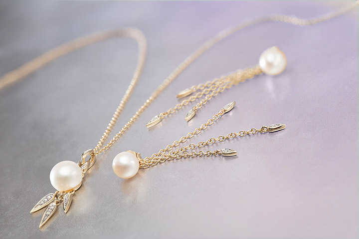 HONORA DIAMOND DROP   Honora   Diamond Drop is a celebration of movement and light.When the gold bezeled-accents and diamonds-by-the-yard catch the light, you will shine like a show-stopper.