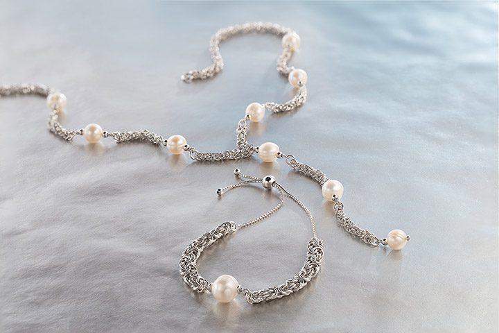 HONORA BYZANTINE REGENERATION   Honora Byzantine Regeneration combines thick woven chains with smooth lustrous pearls for the perfect combination of daring and delicate.