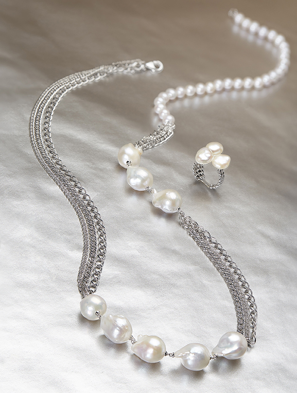 HONORA CURB APPEAL  For those with their finger firmly on the fashion pulse, this fantastically creative collection is for you. Honora   Curb Appeal is a sparkling whirlwind of high-polished curb chains and asymmetrical Baroque Pearls. Not for the faint-hearted.