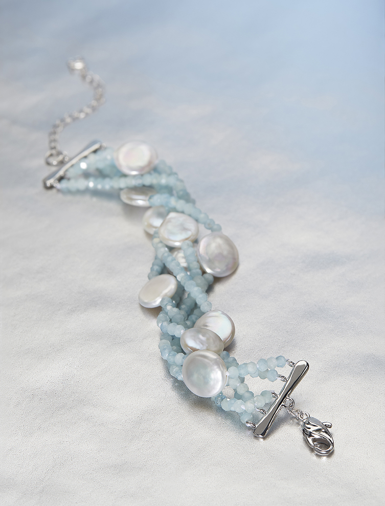 HONORA SOLSTICE   Honora Solstice  is a celebration of the wonders of nature. Cool off and add a splash of color to your wardrobe in our icy blue combination of Aquamarine and luminescent Coin Pearls. For those who like it hot, an additional colorway is available upon request.