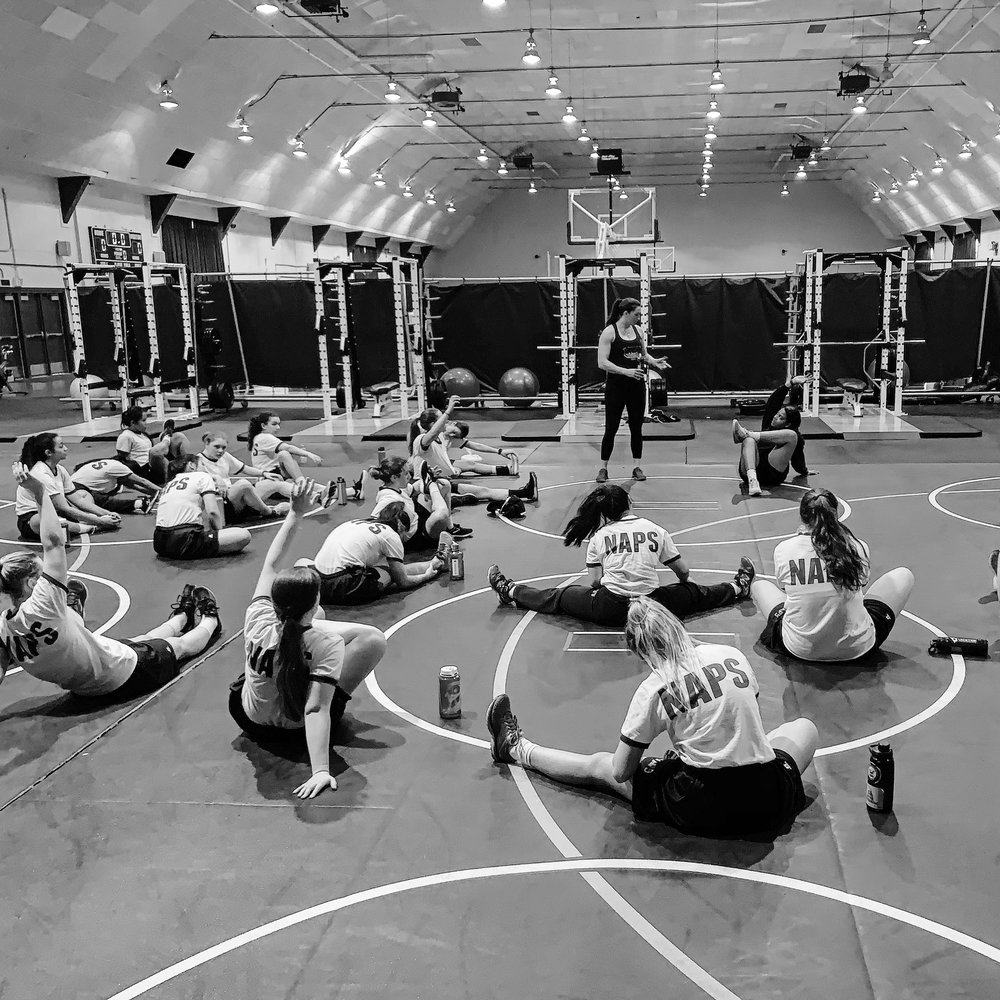 """Naval Academy Preparatory School - February 2019 Taylor presented a leadership presentation to the student body on """"Marine Corps Friday."""" On Saturday, Taylor provided a 2 hour Physical Training + Q&A Session for 50 women. A large number of women were able to learn and perform strength training movements such as a barbell deadlift and a barbell strict press for the FIRST TIME EVER!"""