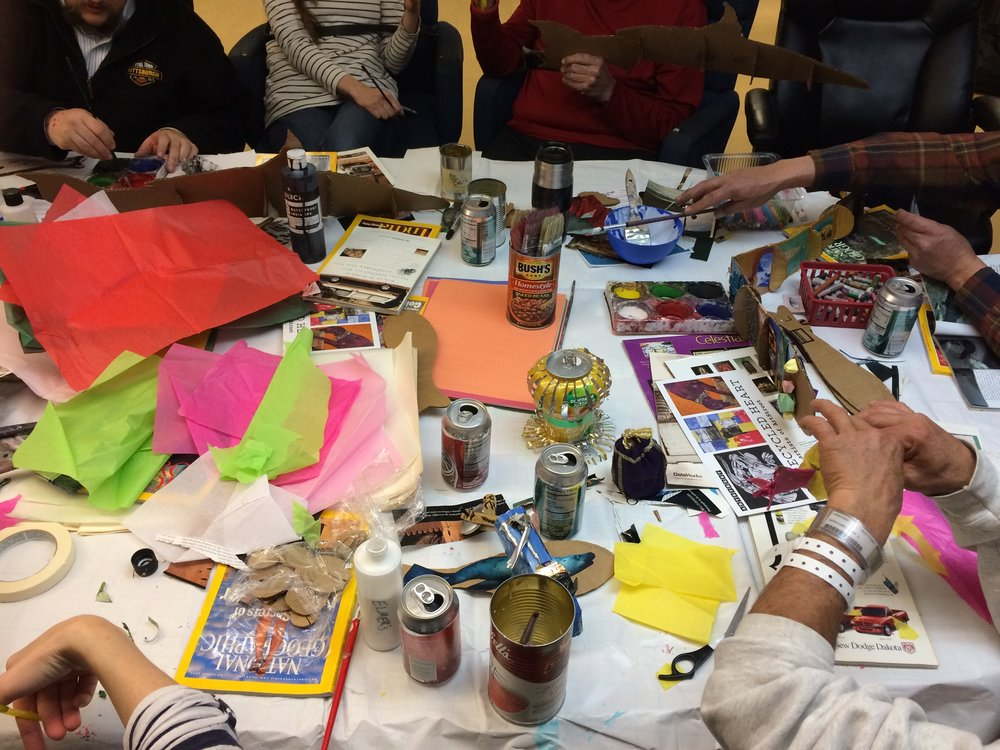 Participants at Heading Home create fish for Collective Memory.