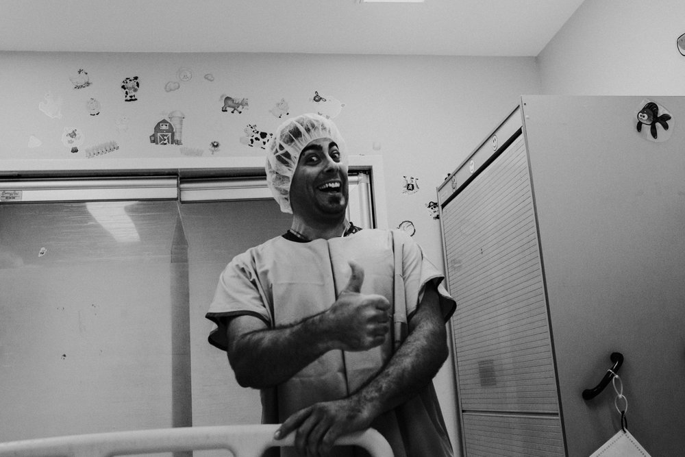 I kiss him goodbye,my baby girl is coming soon.  The man behind the mask has never been so excited too.  We spend most of the day with nurses and inductions. Only to find my body is hesitating.  I have no idea why baby girl, we have been so anxious to meet you lately.