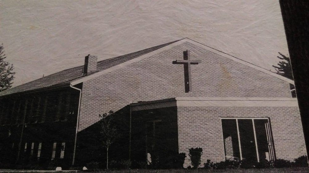 "Our Faithful God - The 2-story house was no longer large enough to house the growing church family. Rev. Smith described the growth of our church as being ""not rapid but steady"".  In the first few years, the membership grew from 39 people to 81 people joining in the worship and ministry of our Great God. On February 7, 1965, the church voted to enter into a building program and by September 19, a short, groundbreaking ceremony was held after Sunday morning services. Many trials and attacks from Satan appeared but through faith in our Lord, a lot of prayer, hard work, and teamwork a new building was constructed. It had an auditorium, 10 classrooms, a nursery, Pastor's study, and fellowship area."