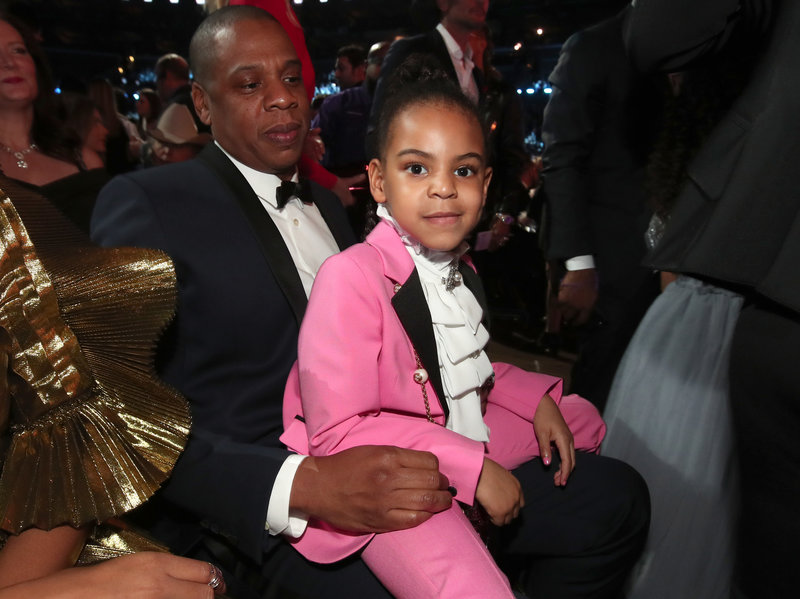Blue Ivy Carter sits on her father, Jay-Z's lap at The 59th Grammy Awards. Christopher Polk/Getty Images for NARAS