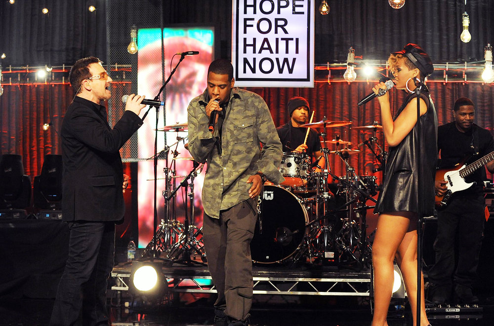 Bono, Jay-Z and Rihanna perform together on stage at the Hope For Haiti Now concert, a global benefit for earthquake relief, at The Hospital Club on Jan. 22, 2010 in London.