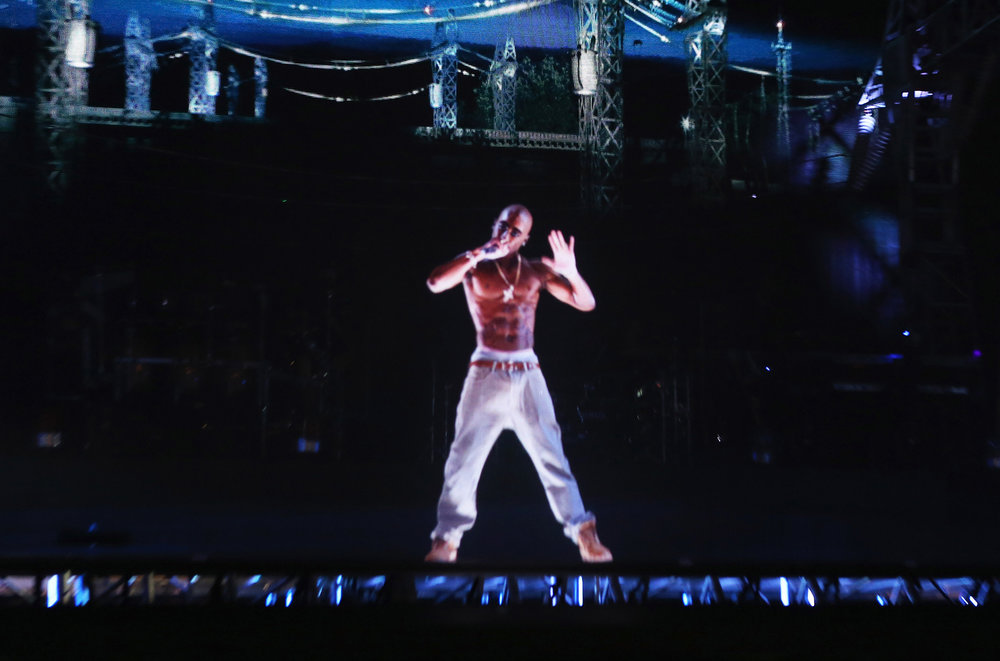 A hologram of deceased rapper Tupac Shakur performs onstage during day 3 of the 2012 Coachella Valley Music & Arts Festival at the Empire Polo Field on April 15, 2012 in Indio, Calif.