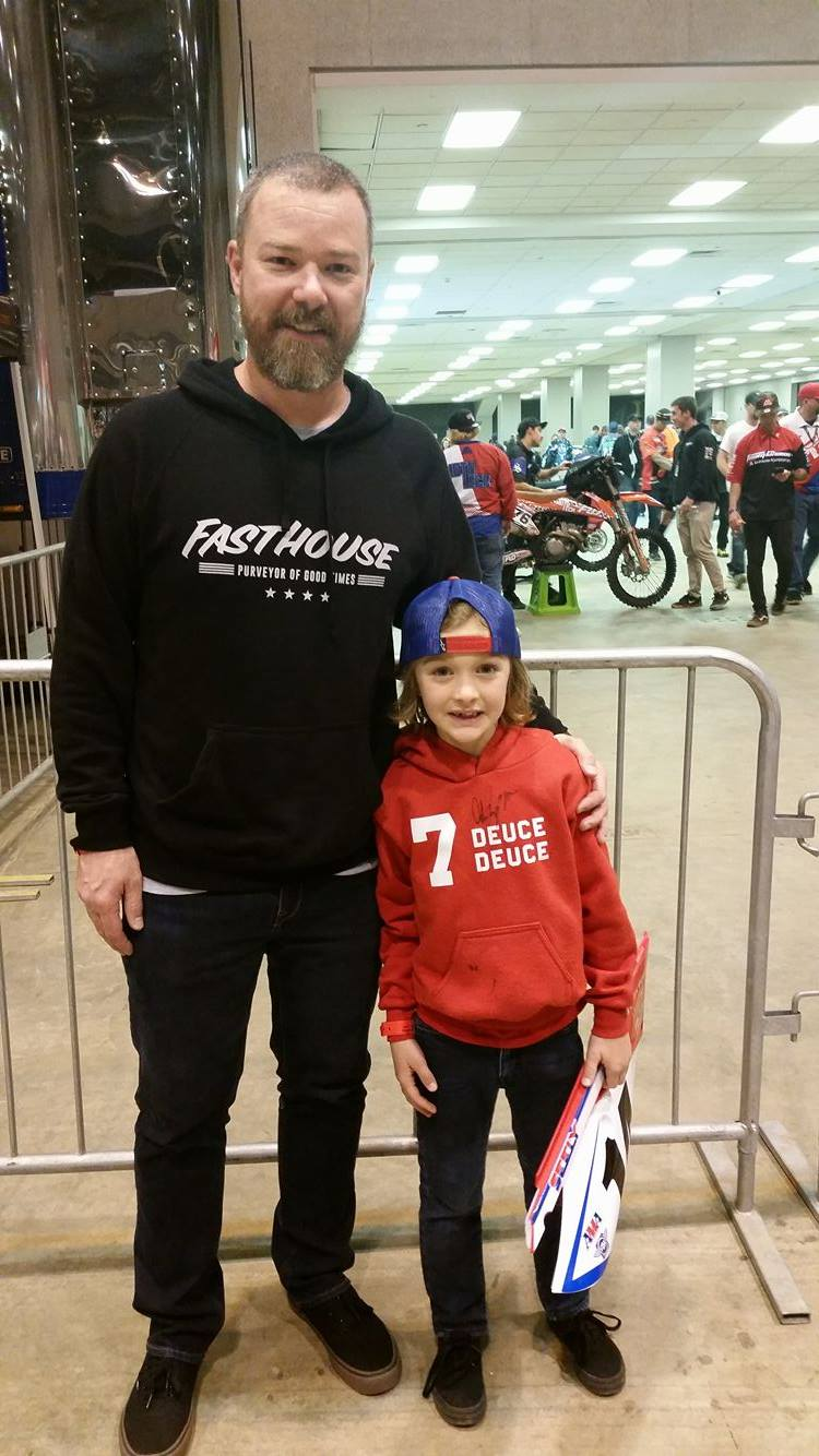 """Owen and his dad got all access passes to the race in St. Louis. There were ready for a long action packed day with the rest of the family and with their favorite riders. We were able to meet up with them early on and start their experience with Adam """"722"""" Enticknap and his team. Owen got tons of cool goodies including a number plate from Cole Seely!"""