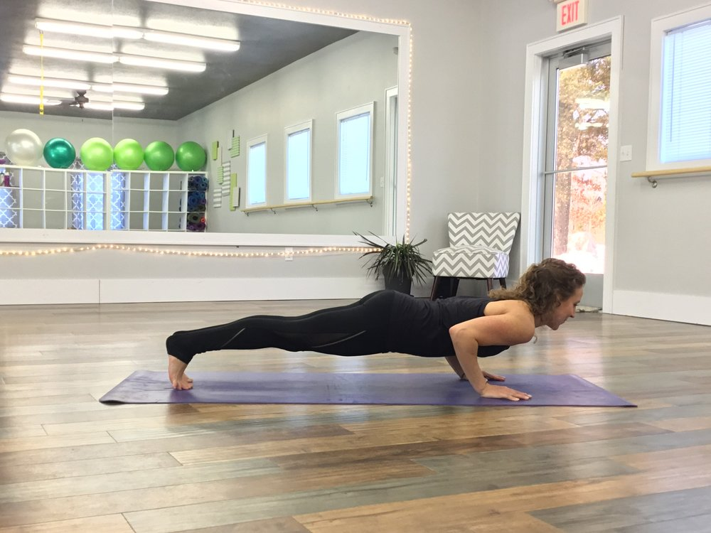 "Chaturanga - I like to call this ""Cowabunga"" because it's fun but difficult. Core, Arms, Wrists will benefit from strength and flexibility. Because of the difficulty of the pose, start in plank pose, begin by lowering your knees to the floor and then, with an exhale, lower your sternum to a few inches from the floor to build up to the full movement with legs fully extended."