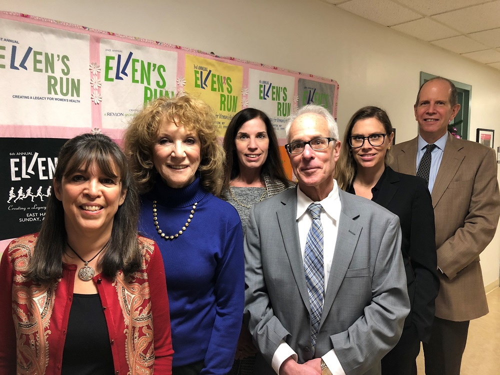 Photo in front of Ellen's Run Posters in SBSH, courtesy of Stony Brook Southampton Hospital, from left: Sara Blue, Special Events Director, The Ellen Hermanson Foundation; Julie Ratner, Ed.D, President, The Ellen Hermanson Foundation; Steve Bernstein, Chief Development Officer, Stony Brook Southampton Hospital; Anne Tschida Gomberg, Executive Director, The Ellen Hermanson Foundation; Amanda Starr Frazier,Esq., Board Member, The Ellen Hermanson Foundation; and Robert S. Chaloner, Chief Administrative Officer, Stony Brook Southampton Hospital.