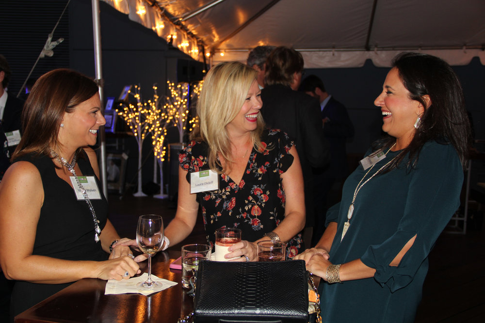Three women socializing at event