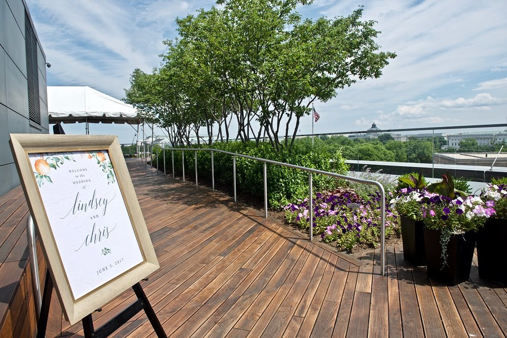 Wedding ceremony signage with event space in background