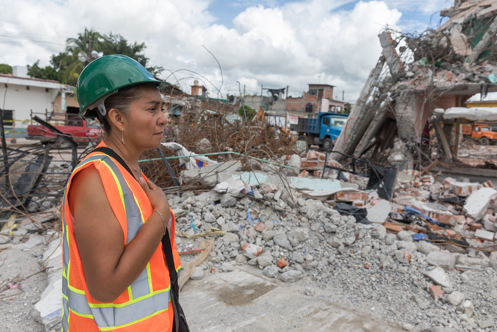 Verónica Bravo Santamaria looking at her home as it is being demolished. Six people lived in the house including her husband, her children Francisco Antonio and Mari José, and her in-laws. They are currently sleeping in their truck. PHOTO: Francisco Alcala Torreslanda