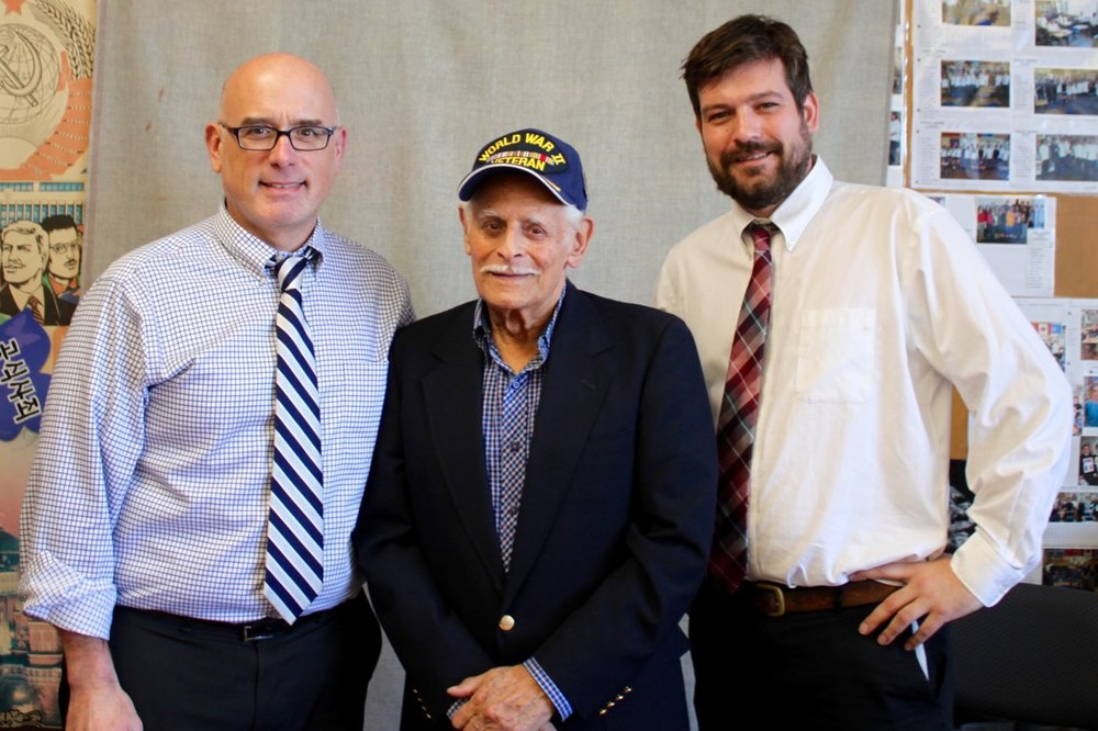 Teachers Scott Masters and Jason Hawkins with Second World War veteran Jack Boeki.