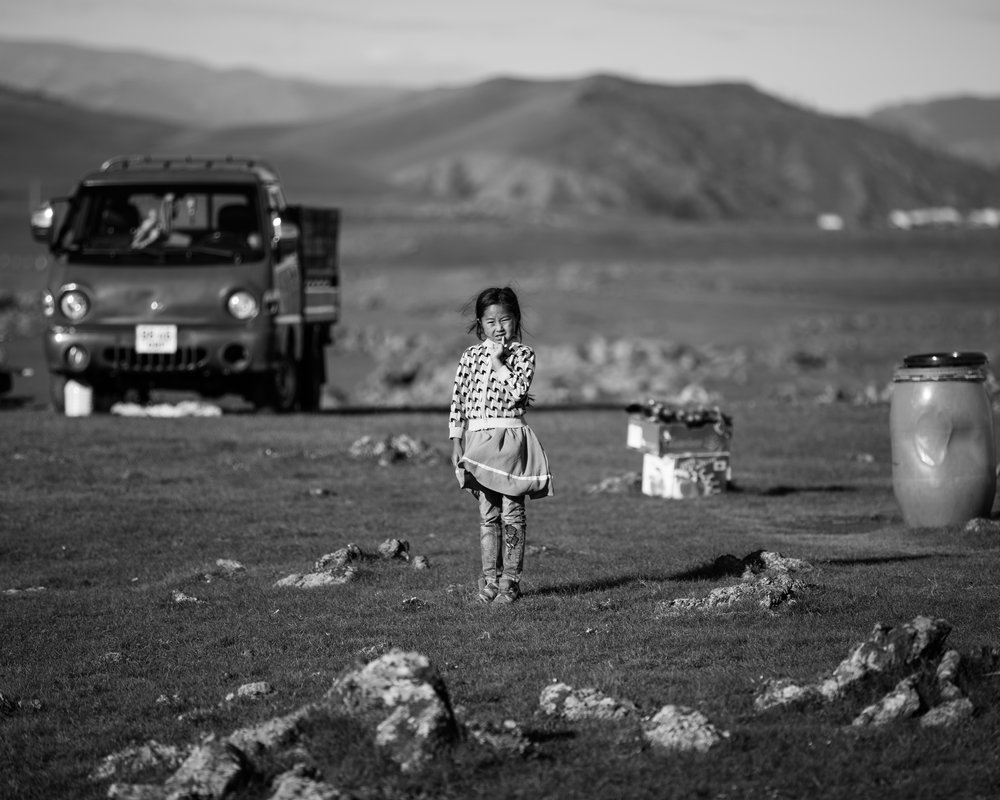 Photo by Daniel Fast  Buyanbadrakh 'Buyan'—the youngest child of the second family we stayed with— stands in the middle of the family's camp, surrounded by her endless backyard. Orkhon Valley, Ovorkhangai, Mongolia.