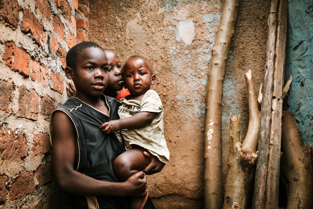 Two of Zarika's children, Mukile (12 years) and Minala (9 years) babysitting the neighbour's children.  Photo by Sandra Jasmin