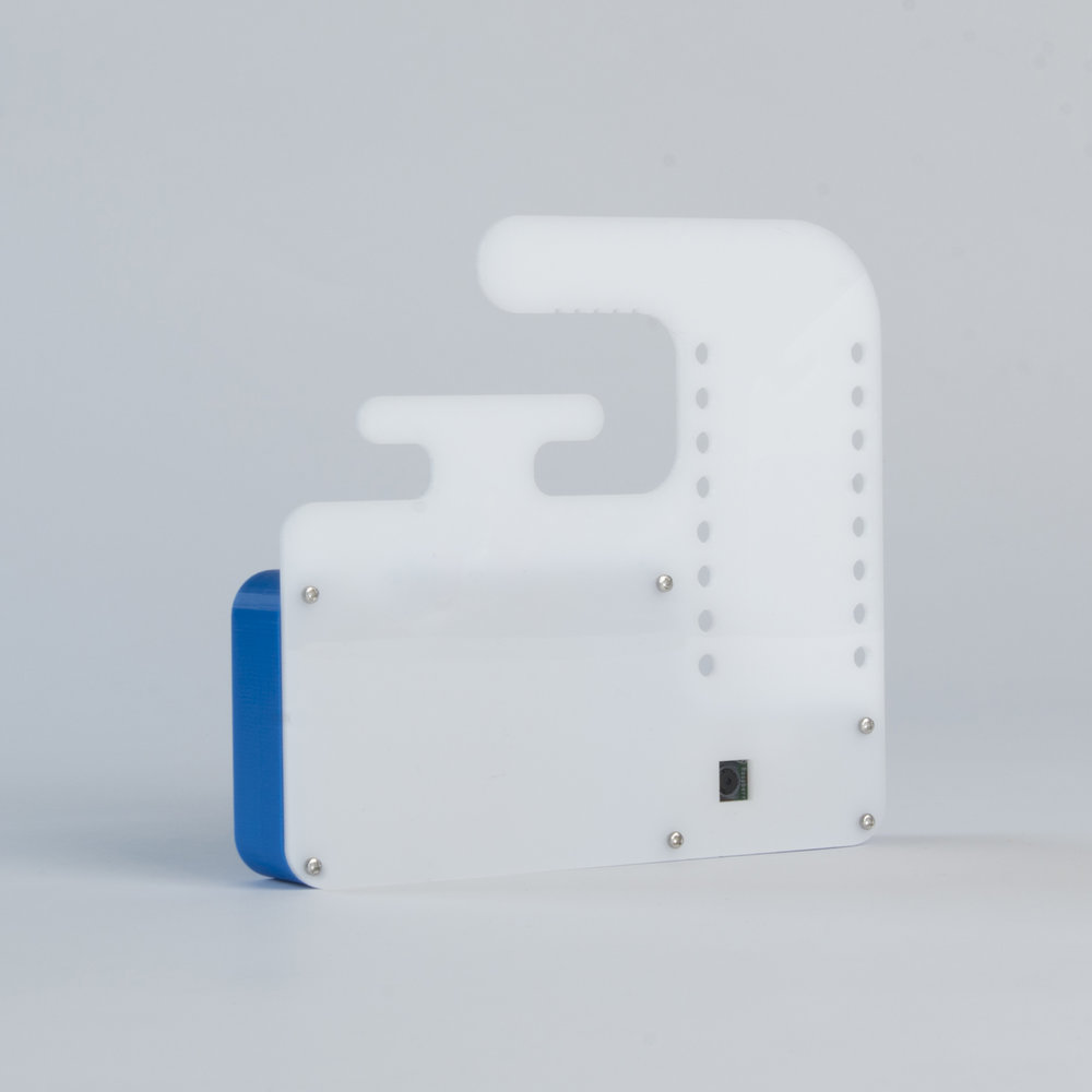 Camera with Lasercut Hanger - Type B   This housing is made from a 3D printed shell and a lasercut acrylic rear panel. The panel features perforations for attaching a USB battery with cable ties or elastic bands, hooks for wrapping the USB power cable and a hook for hanging the camera itself..  more